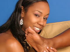 A pair of sexy ebony sluts sucking toes and using dildos. Nyomi Banxxx & Misty Stone