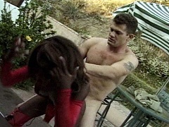 Kinky ebony babe fucking a white man in the back yard. Monique, watch free porn video.