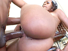 Ebony babe gives blowjob and hard fucking on a chair
