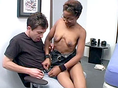 Horny black mature in glasses takes young white dude's dick