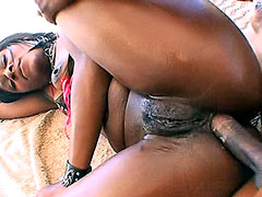 Oiled ebony MILF sucking long cock and gets anal fucked outdoor