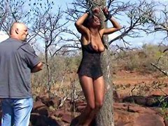 Ebony chick hang on a tree before pussy fucking