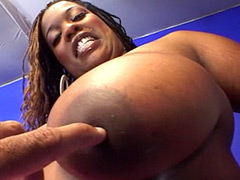 Black babe with gigantic boobs gets hard cock in condom