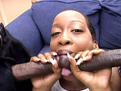 Ebony babe sucks two huge black dicks at once and swallows