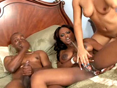 Ebony lesbians pissing each other after good black cock sex