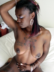 Tattooed girlfriends poses fully naked and jerks dicks