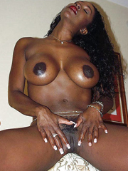 Busty ebony housewife with the fake huge boobs is waiting for her love