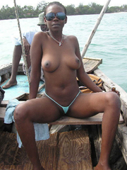Mature black woman from Nigeria fucked on a boat with three blacks