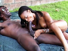 Naughty ebony slut Marie Luv enjoys sucking a massive black dick