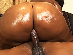 Black fatty rides a dick on the couch. Tinah Taboo