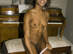 Dirty slut, Marie Luv, strips down to her chocolate nipples and nude pussy