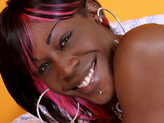 A fit physique and entrancing eyes make this ebony tgirl a sight to be seen