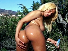 Blonde ebony Destiny Dreams beckons us with her sexy moist from the oil body