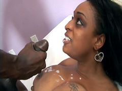 Busty black whore Carmen Hayes gets cum on a tits