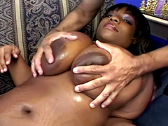 Busty ebony Crystal Clear lying on the sofa and waiting for some oral action from white man