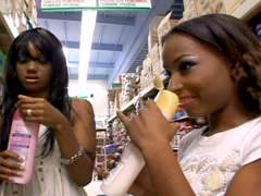Two young black babes catch each other's eye as they are shopping in the supermarket. At home they..