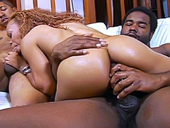 As Melrose Foxxx kneels in front of them, they whip out their big black boners and place them in..