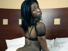 Ebony tranny Deja has got suckable perky tits and a nice chocolate cock!