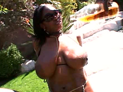 Horny ebony pornstar Delotta Brown shows us her huge natural brown tits