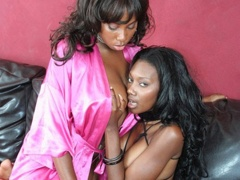 Long haired black hotties using a strap on to have hot sex. Candice Von and Nyomi Banxxx