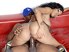 Tattooed black babe does her own cowgirl over black dick