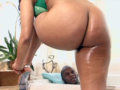 This Tia Cherry video starts off with her riding the dong in the bath, and the dick looks large..