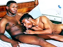 Two black men with big black dicks are fucking on a bed. They each finish themselves off by..