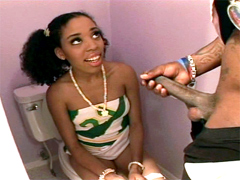 Young ebony girl sucking cock sitting on the toilet