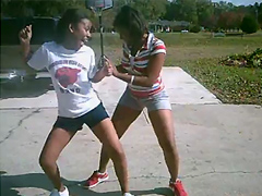 Two perky black woman dancing in the street